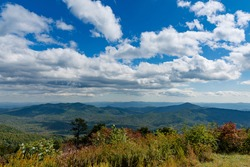 Blue Sky and clouds over the Blue Ridge Mountains on an autumn day near the Blue Ridge Parkway in Asheville, North Carolina
