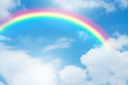 Blue sky and clouds with rainbow.