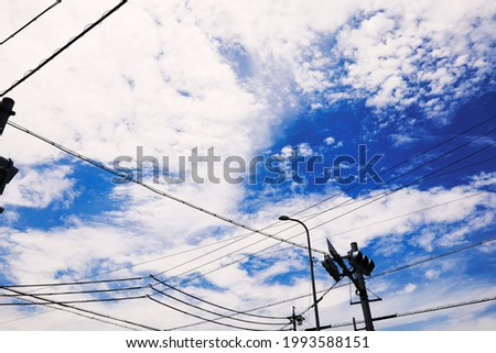 Blue sky and electric wires with beautiful contrast with clouds