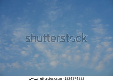 Blue sky and fluffy white clouds. Clouds in the blue sky.Clouds in the blue sky. Blue sky and volumetric white clouds.