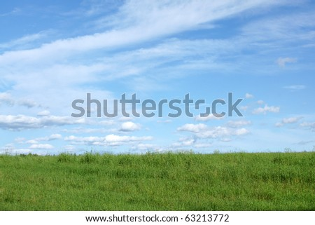 Blue sky and green field, for backgrounds or textures