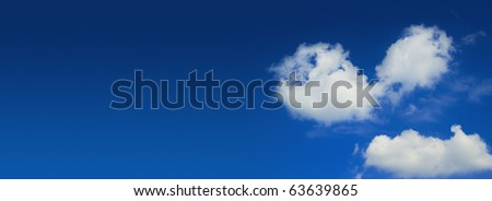 Blue sky and heart shape clouds wide panorama
