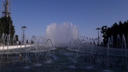 blue sky and magnificent fountain symmetrically shot