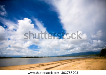 Blue sky and sea and sand background lens blur concept.
