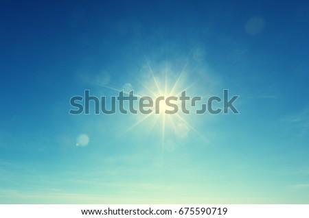 blue sky and sun - Shutterstock ID 675590719