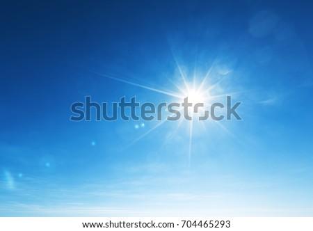 blue sky and sun - Shutterstock ID 704465293