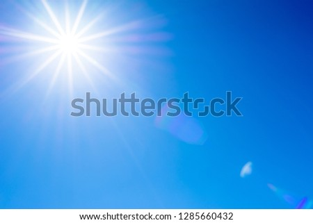 Blue sky and sun with flare #1285660432