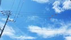 Blue sky and telephone pole