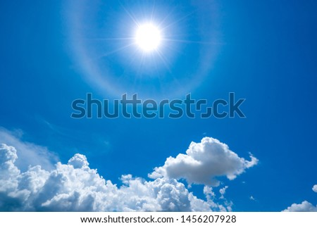 Blue sky and white cloud on sun halo beautiful background, sky is everything lies above surface Earth atmosphere and outer space. Cloud is aerosol comprising visible mass of liquid droplets #1456207928
