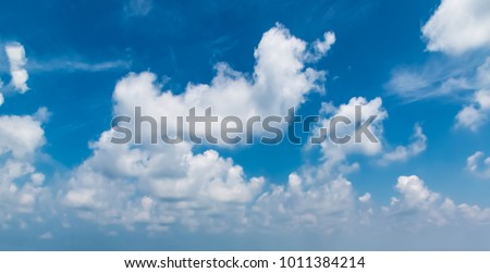 Blue sky and white clouds - Shutterstock ID 1011384214