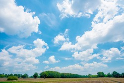 blue sky and white clouds..blue back ground.Freshness of the new day. Bright blue background. Relaxing feeling like being in the sky.Landscape image of blue sky and thin clouds.
