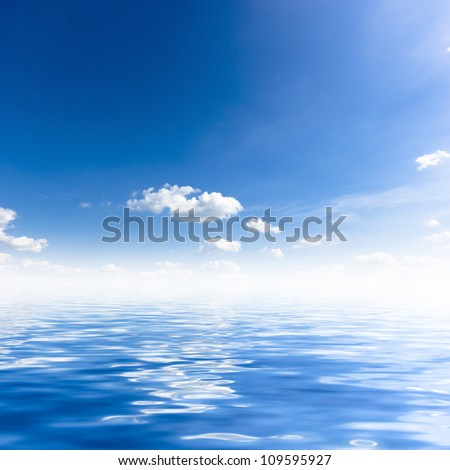 Blue sky and white clouds with reflection in water