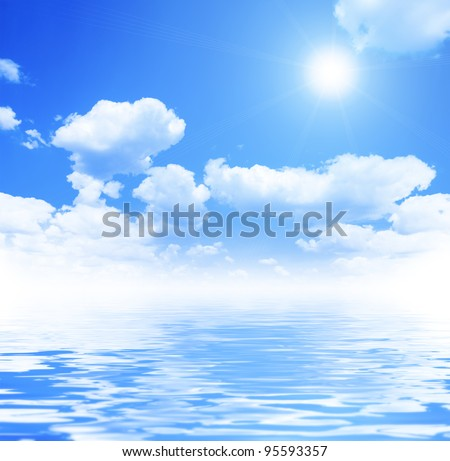 Blue sky and white clouds with reflection in water - stock photo