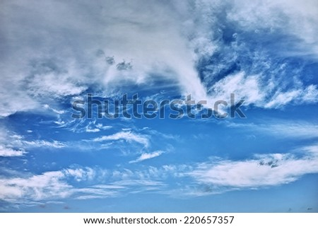Blue sky and white flowing clouds background for the concept of sleep, dream and illusion