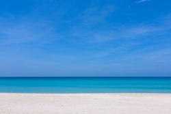 Blue sky and white sand at a beach in Sabah, East Malaysia, Borneo