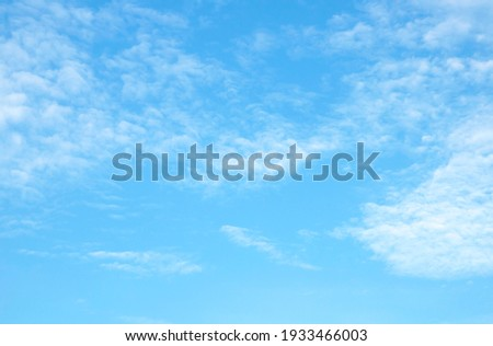 Blue sky background and white clouds soft focus