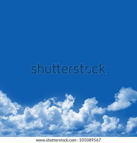 Blue Sky Background With Clouds and Space for Text Isolated on Blue