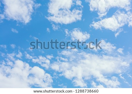 Blue sky background with clouds and sun light