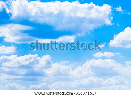 blue sky background with tiny clouds - Shutterstock ID 316371617