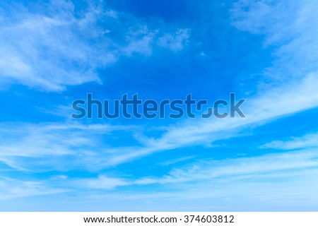 blue sky background with tiny clouds - Shutterstock ID 374603812