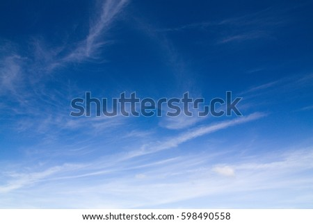 blue sky background with tiny clouds - Shutterstock ID 598490558