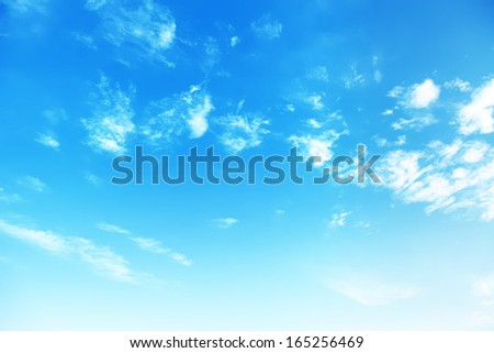 Blue sky background with white clouds. - Shutterstock ID 165256469