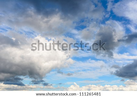 blue sky background with white clouds and black clouds