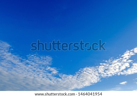 Blue sky background with white clouds. Copy space.  #1464041954