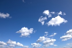 blue sky background with white clouds in the afternoon with a sunny day  in the summertime in Denmark