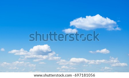 Blue sky background with white cumulus clouds, - Shutterstock ID 697181056