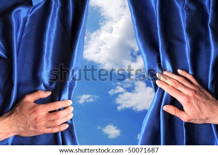 blue sky behind curtain and hand with copyspace fpr text message