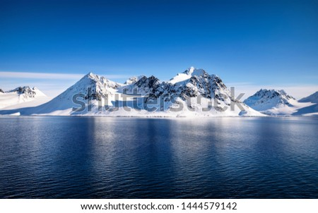 Blue sky, blue and snowy mountains in the beautiful fjords of Svalbard, a Norwegian archipelago between mainland Norway and the North Pole Сток-фото ©