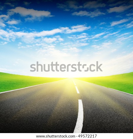Blue sky,empty road and sun.