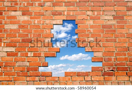 blue sky hole in aged brick wall background