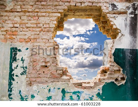 blue sky in a hole on a background an old wall