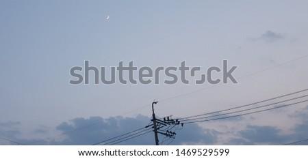blue sky in urban midnight moon