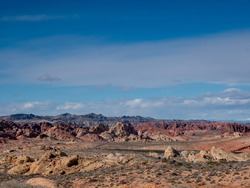 Blue sky over a road through beautiful rugged desert terrain at Valley of Fire State Park, Nevada, USA