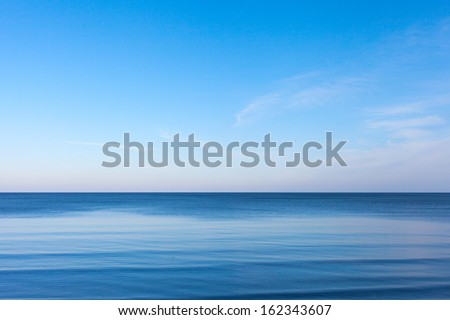 Blue sky over blue Baltic sea.