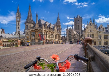 Shutterstock Blue sky over Gent, Belgium, with a traditionally decorated bicycle in the foreground