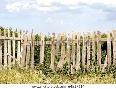 blue  sky over old wooden fence