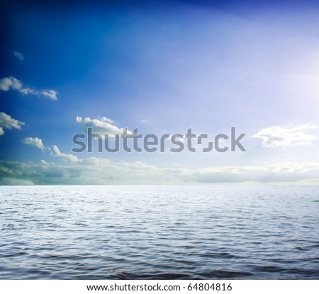 Blue sky over water #64804816