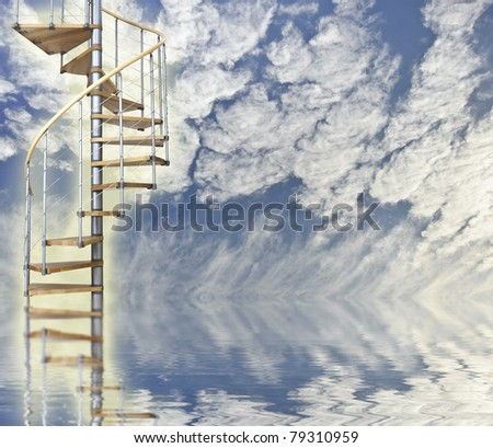 Blue sky reflected in water with glowing spiral stairway to heaven