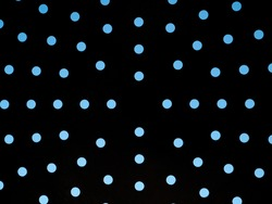 Blue sky through round holes in the dark. Background image. Place for your text. Black shadow.