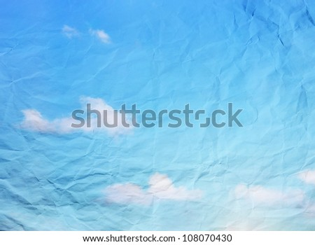 Blue sky vintage background on crashed paper