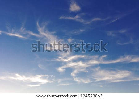 blue sky with a flying clouds