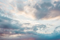 Blue sky with a pastel colored. Soft texture of fluffy clouds. Concept for airy light dreams and travel.