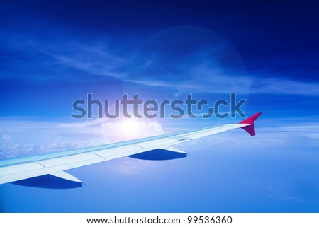 blue sky with airplane wing