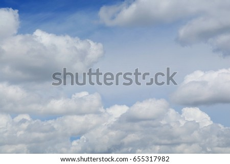 Blue sky with big shape cumulus cloud in the afternoon. Soft focus. Background concept with copy space. - Shutterstock ID 655317982