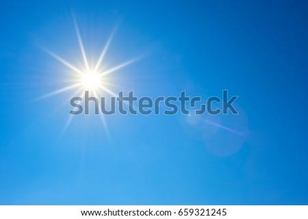 Blue sky with bright sun #659321245