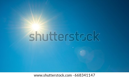 Blue sky with bright sun #668341147
